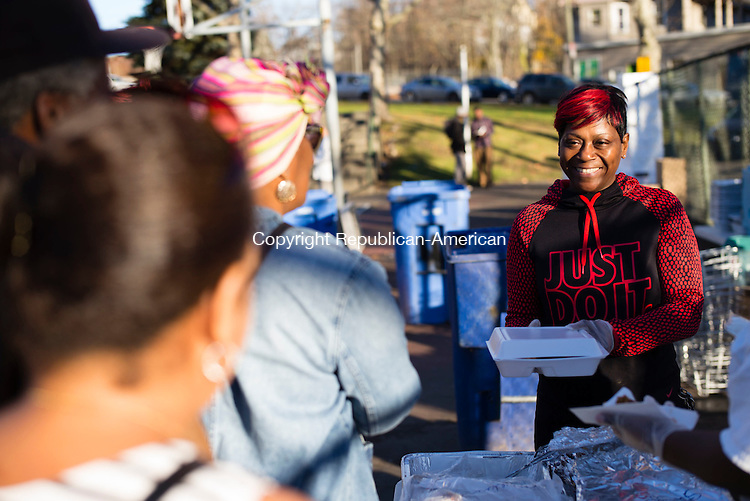 Waterbury, CT- 19 November 2016-111916CM09- Shamiaha Knight a volunteer from Mama Sue's Kitchen serves food during a Thanksgiving Outreach in Martin Luther King Park in Waterbury on Saturday.  The event put on by Christ Church, provided food, clothing items and blankets.  Christopher Massa Republican-American