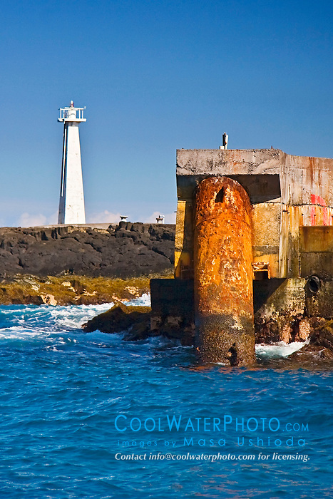 "Lighthouse and deep seawater supply pipe of NELHA (National Energy Laboratory of Hawaii Authority) at Keahole Point, the 1m (40"") in diameter, 6,284 foot long pipeline caters 6ºC (43ºF) cold deep seawater from 2,000-foot depths to over 30 thriving enterprises in the industrial park, off Kona Coast, Big Island, Hawaii, Pacific Ocean."