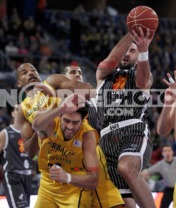 Herbalife Gran Canaria's Eulis Baez (l) and Javier Beiran (c) and Uxue Bilbao Basket's Milovan Rakovic during Spanish Basketball King's Cup match.February 07,2013. (ALTERPHOTOS/Acero)