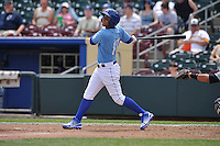 Omaha Storm Chasers Ramon Torres (17) swings during the game against the El Paso Chihuahuas at Werner Park on May 30, 2016 in Omaha, Nebraska.  El Paso won 12-0.  (Dennis Hubbard/Four Seam Images)