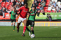 Anfernee Dijksteel of Charlton Athletic and Scunthorpe's Josh Morris challenge for the ball during Charlton Athletic vs Scunthorpe United, Sky Bet EFL League 1 Football at The Valley on 14th April 2018