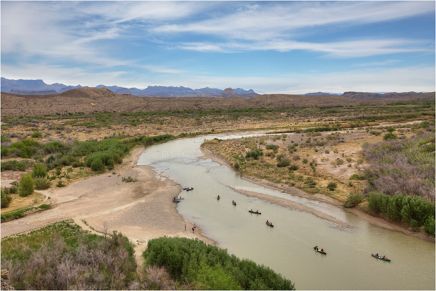 From high above the cliffs of Saint Elena Canyon, the Chisos Mountains can be seen in the distance in Big Bend National Park. This remote location in south Texas is a hikers' and photographers' paradise. I imagine the canoers are having a good time, as well, on this perfect spring day.