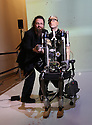 "World's first bionic man at Science museum today.5.2.13..Pic shows: the man who built the bionic man Rich Walker - CEO of Shadow Robots...Bertold Meyer - who has a bionic hand himself - with the robot ""Rex"".as TV crews look on.Face of Rex was modelled on Bertold....Pic by Gavin Rodgers/Pixel 8000 Ltd"