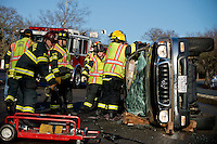 Santa Rosa firefighters work to extricate a driver whose truck rolled over in the westbound lanes of Fountaingrove Parkway in Santa Rosa, Calif., on January 11, 2014. (Alvin Jornada / The Press Democrat)