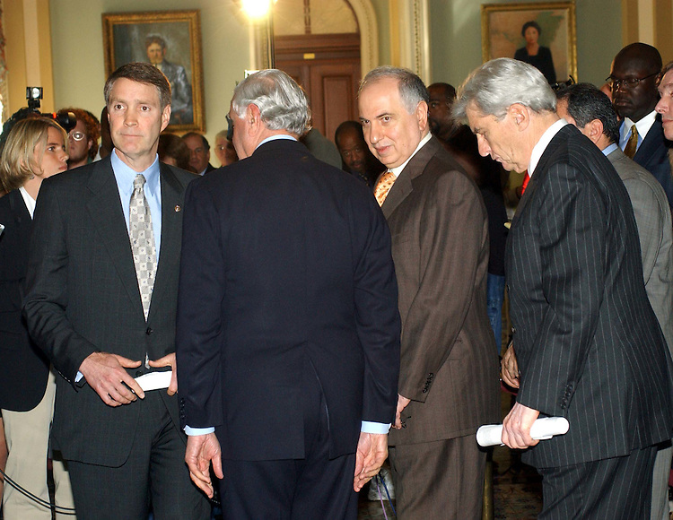 9/30/03.IRAQ GOVERNING COUNCIL MEETING WITH SENATORS--After a lunch meeting with Senate Majority Leader Bill Frist, R-Tenn., left, and Sen. John W. Warner, R-Va., far right, and members of the Iraq Governing Council at the end of a news conference in the Ohio Clock Corridor. Members are Dr. Ahmad Chalabi, president of the Council and leader of the Iraqi National Congress since 1992, wearing yellow tie; Adnan Pachachi, who has been part of the Iraqi opposition since 1998, obscured; and Foreign Minister Hoshyar Zebari, who was appointed by the Council and a member of the Kurdish Democratic Party Leadership and the Iraqi Naitonal Congress, next to Frist. Senate Minority Leader Tom Daschle, D-S.D., Sen. Mitch McConnell, R-Ky., Sen. Harry Reid, D-Nev., and Sen. Carl Levin, D-Mich., also attended the meeting..CONGRESSIONAL QUARTERLY PHOTO BY SCOTT J. FERRELL