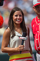 ESPN reporter Kaylee Hartung smiles during Game 3 of the 2013 Men's College World Series between the North Carolina State Wolfpack and North Carolina Tar Heels at TD Ameritrade Park on June 16, 2013 in Omaha, Nebraska. The Wolfpack defeated the Tar Heels 8-1. (Brace Hemmelgarn/Four Seam Images)