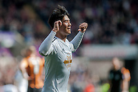 SWANSEA, WALES - APRIL 04: Ki Sung-Yueng of Swansea City  Celebrates his goal during the Premier League match between Swansea City and Hull City at Liberty Stadium on April 04, 2015 in Swansea, Wales.  (photo by Athena Pictures)