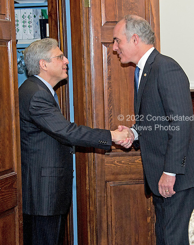 United States Senator Bob Casey, Jr. (Democrat of Pennsylvania), right, shakes hands with Judge Merrick Garland, chief justice for the US Court of Appeals for the District of Columbia Circuit, left, who is US President Barack Obama's selection to replace the late Associate Justice Antonin Scalia on the US Supreme Court, left, as the Judge arrives for a photo op on Capitol Hill in Washington, DC on Tuesday, March 22, 2016.   <br /> Credit: Ron Sachs / CNP