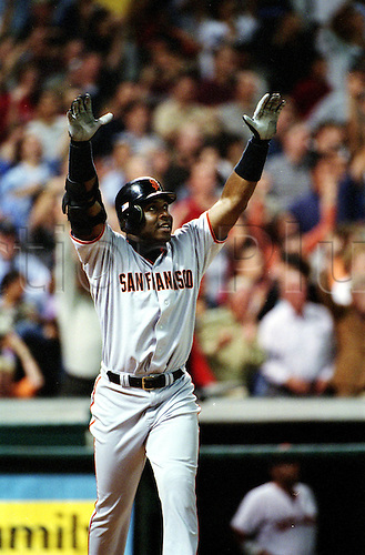 4 Oct 2001:  Barry Bonds of the San Francisco Giants celebrates dashing into the record books after hitting his 70th home run into the upper deck during the Gaints 10-2 victory over the Houston Astros at Enron Field in Houston, Texas, USA.  Bonds tied Mark McGwire's single-season record with the shot. Photo:  John Biever/SI/Icon/actionplus...011004.basebal.US sports.american celebration celebrating celebrate joy