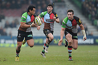 20130309 Copyright onEdition 2013©.Free for editorial use image, please credit: onEdition..Maurie Fa'asavalu of Harlequins (left) in action as Tom Guest of Harlequins (right) supports during the LV= Cup semi final match between Harlequins and Bath Rugby at The Twickenham Stoop on Saturday 9th March 2013 (Photo by Rob Munro)..For press contacts contact: Sam Feasey at brandRapport on M: +44 (0)7717 757114 E: SFeasey@brand-rapport.com..If you require a higher resolution image or you have any other onEdition photographic enquiries, please contact onEdition on 0845 900 2 900 or email info@onEdition.com.This image is copyright onEdition 2013©..This image has been supplied by onEdition and must be credited onEdition. The author is asserting his full Moral rights in relation to the publication of this image. Rights for onward transmission of any image or file is not granted or implied. Changing or deleting Copyright information is illegal as specified in the Copyright, Design and Patents Act 1988. If you are in any way unsure of your right to publish this image please contact onEdition on 0845 900 2 900 or email info@onEdition.com
