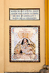 Sign and religious poster Fiestas del Rosario, Church of San Antonio Abad, Seville, Spain