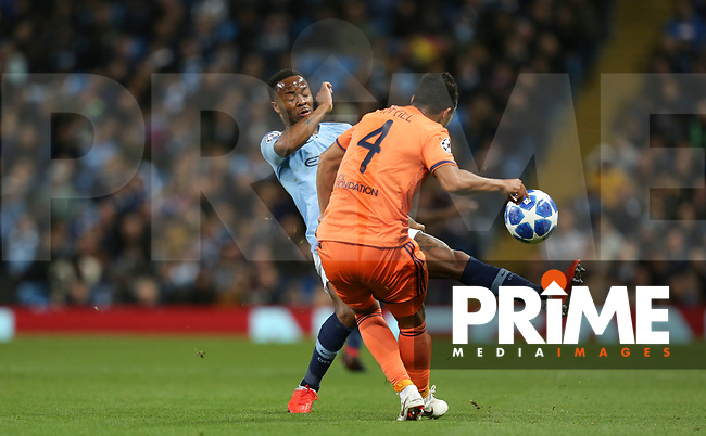Raheem STERLING of Manchester City & RAFAEL of Olympique Lyonnais during the UEFA Champions League match between Manchester City and Olympique Lyonnais at the Etihad Stadium, Manchester, England on 19 September 2018. Photo by David Horn / PRiME Media Images.