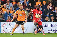 Tom Bolarinwa and Max Clark fight for the ball during the Sky Bet League 2 match between Cambridge United and Grimsby Town at the R Costings Abbey Stadium, Cambridge, England on 15 October 2016. Photo by PRiME Media Images.
