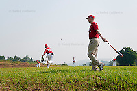 Canadian player Connor McCreath throws a ball during warm up in Mpigi, Uganda on January 17 2012 while Canadian head coach Dean Cantelon watches.