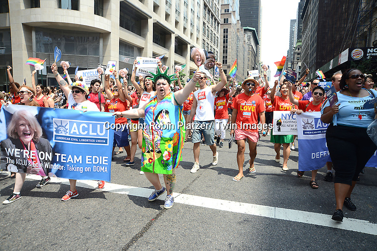 Marchers attends the NYC 2013 Gay Pride Parade on June 30, 2013 on Fifth Avenue in New York City. The 3 Grand Marshalls were Harry Belafonte, Edie Windsor and <br /> Earl Fowlkes.