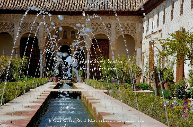 Water fountains in the courtyard at Alhambra, a 14th-century palace in Granada, Andalusia, Spain.