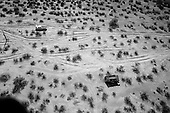 Tohno O'odham Indian Reservation, Arizona<br /> USA<br /> August 24, 2007<br /> <br /> The National Guard patrols the skies over the Arizona desert. They are in search of Mexican smugglers and illegal immigrants crossing into the US. In five years, rangers at Organ Pipe have recovered 200 abandoned vehicles. The vehicles (usually stolen US vehicles) often break down in the desert during the trip north and are left behind by drug smugglers. The Arizona deserts are littered with these vehicles that are left along makeshift roads, also created by the smugglers.<br /> <br /> The National Guard cannot arrest smugglers but can report them directly to the border patrol. Of the 6,000 National Guard that began deployment in Arizona on the US Mexican border in 2006, half now remain.