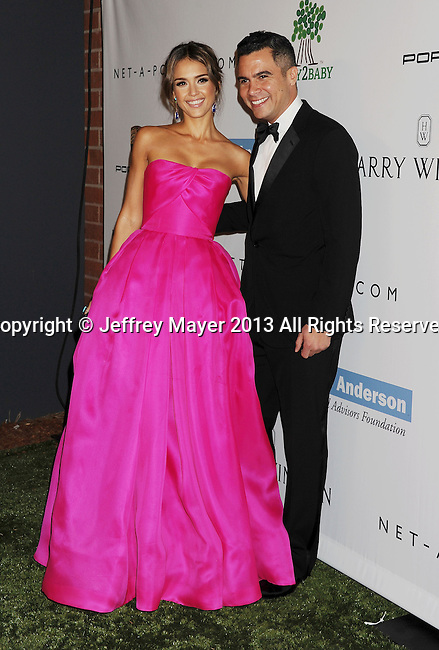CULVER CITY, CA- NOVEMBER 09: Actress Jessica Alba (L) and husband/producer Cash Warren arrive at the 2nd Annual Baby2Baby Gala at The Book Bindery on November 9, 2013 in Culver City, California.