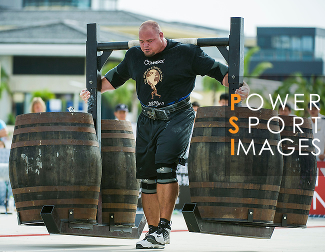 HAINAN ISLAND, CHINA - AUGUST 23:  Brian Shaw of USA competes at the Super Yoke event during the World's Strongest Man competition at Serenity Marina on August 23, 2013 in Hainan Island, China.  Photo by Victor Fraile