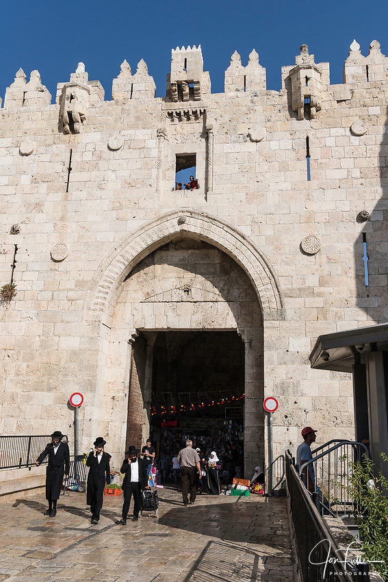 Three Haredic or Ultra-Orthodox Jewish men by the Damascus Gate on the north side of the Old City of Jerusalem.  The Old City of Jerusalem and its Walls - UNESCO World Heritage Site