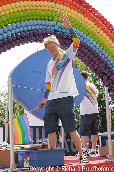 A young man rides on one of the floats of the Pride Parade in Montreal