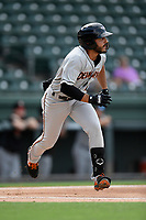 Designated hitter Alexis Torres (7) of the Delmarva Shorebirds runs out a batted ball in a game against the Greenville Drive on Friday, August 2, 2019, in the continuation of rain-shortened game begun August 1, at Fluor Field at the West End in Greenville, South Carolina. Delmarva won, 8-5. (Tom Priddy/Four Seam Images)