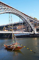 Dom Luis I bridge seen from Cais da Ribeira barco rabelo shipping boat porto portugal