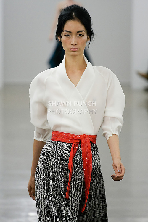 Sera walks runway in an outfit from the Carmen Marc Valvo Spring 2013 collection fashion show, during Mercedes-Benz Fashion Week Spring 2013.
