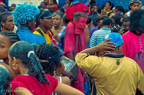 A close up crowd scene, men, women, black community of Paramin, jostle for views of the Blue devils, Jab Jabs, Trinidad