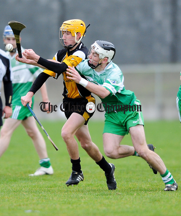 Colm Galvin of Clonlara in action against John Guilfoyle of Wolfe Tones during their Minor B county final at Clarecastle. Photograph by John Kelly.