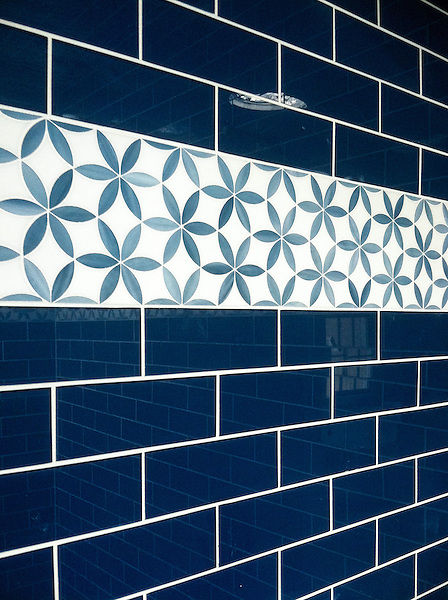 Fiona, a jewel glass waterjet mosaic, shown in Jade and Absolute White.