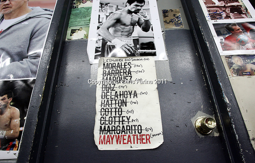 "April 21, 2011, Hollywood,Ca. --- ""MANNY'S TO DO LIST"" ---  Superstar Manny Pacquiao's list of past and maybe future opponents hang on his dressing room at the Wildcard Boxing Club in Hollywood. Pacquiao is in intense preparation for his upcoming World Welterweight mega fight against ""Sugar"" Shane Mosley on Saturday, May 7 at the MGM Grand in Las Vegas.  Pacquiao vs Mosley is promoted by Top Rank in association with MP Promotions,Sugar Shane Mosley Promotions,Tecate and MGM Grand.  The Pacquiao vs Mosley telecast will be available live on SHOWTIME Pay Per View.  --- Photo Credit : Chris Farina - Top Rank  (no other credit allowed)  copyright 2011"