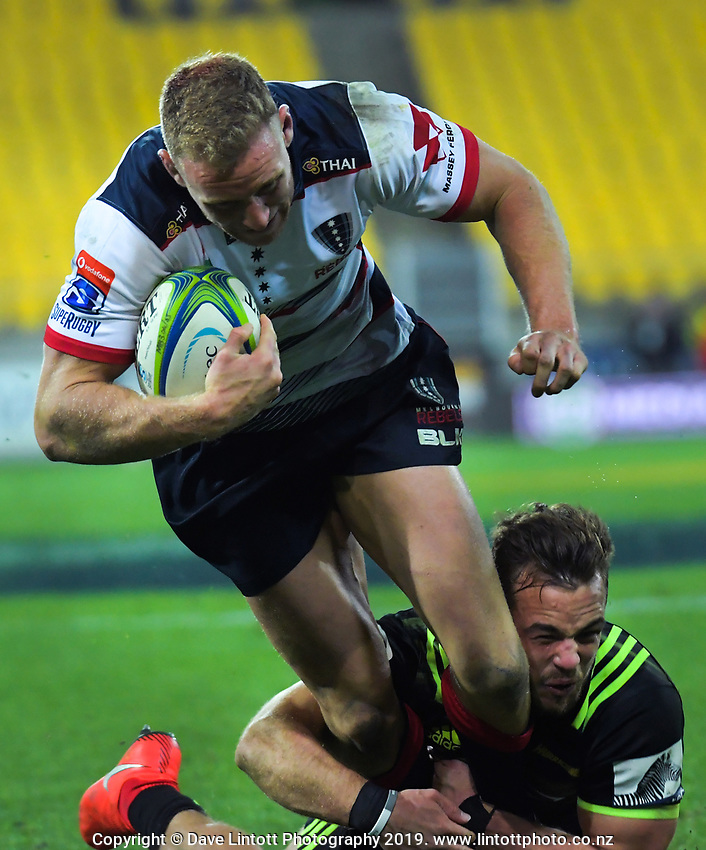 Reece Hodge scores in the tackle of Wes Goosen during the Super Rugby match between the Hurricanes and Rebels at Westpac Stadium in Wellington, New Zealand on Saturday, 4 May 2019. Photo: Dave Lintott / lintottphoto.co.nz
