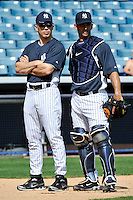 Feb 23, 2010; Tampa, FL, USA; New York Yankees manager Joe Girardi (28) talks to catcher Jorge Posada (20) during  team workout at George M. Steinbrenner Field. Mandatory Credit: Tomasso De Rosa