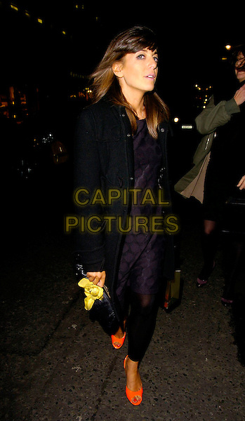 CLAUDIA WINKLEMAN.The Donna Karan Gold Fragrance Collection Launch, Donna Karan, New Bond Street, London, UK..November 16th, 2006.Ref: CAN.full length black coat jacket orange shoes.www.capitalpictures.com.sales@capitalpictures.com.©Can Nguyen/Capital Pictures