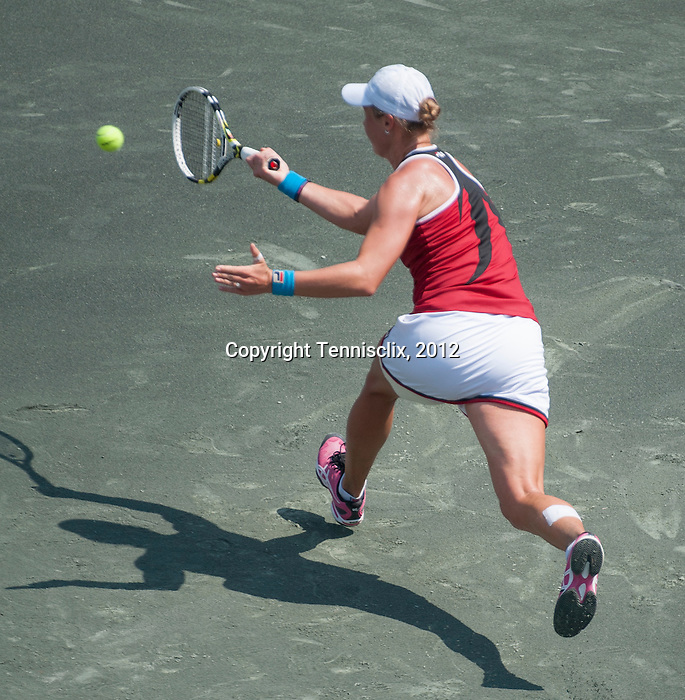 Vera Dushevina (RUS) battles at the Family Circle Cup in Charleston, South Carolina on April 4, 2012