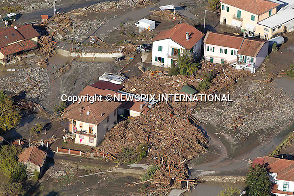 "*** EXCLUSIVE! _ Must Telephone: +441279 324672 To Agree Fees Prior To Use ***.MUDSLIDES AND FLOODING RAVAGE SCENIE ITALIAN RIVIERA.Mud, uprooted trees and debris are washed up against the houses in Brugnato, Italy_26/10/2011.Mandatory Credit Photo: ©NEWSPIX INTERNATIONAL..**ALL FEES PAYABLE TO: ""NEWSPIX INTERNATIONAL""**..IMMEDIATE CONFIRMATION OF USAGE REQUIRED:.Newspix International, 31 Chinnery Hill, Bishop's Stortford, ENGLAND CM23 3PS.Tel:+441279 324672  ; Fax: +441279656877.Mobile:  07775681153.e-mail: info@newspixinternational.co.uk"