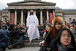 "Good Friday, Passion Play ""Passion in the Square"" Trafalgar Square thousands gather to watch annual performance by the Wintershall Players. London UK. James Burke-Dunsmore play the lead role in the play ""The Passion of Jesus"". Young woman, overcome with emotion as she watches the performance on the large screen. 29th March 2013."