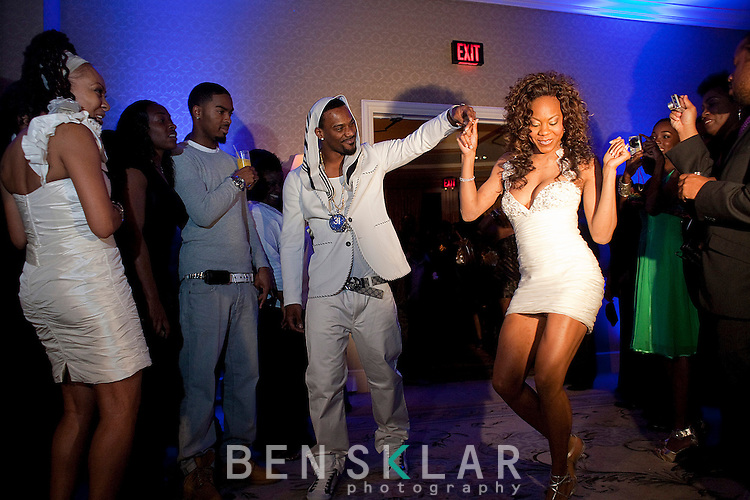Ross and Richards enter the after party to a crowd of guests and synchronized music. Olympic gold medalist, Sanya Richards, and New York Giants cornerback, Aaron Ross, wed at the Hyde Park Baptist in Austin, Texas on Friday, February 26, 2010...