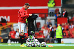Wayne Rooney of Manchester United empties a bag of balls on the pitch during the Premier League match at Old Trafford Stadium, Manchester. Picture date: September 24th, 2016. Pic Sportimage