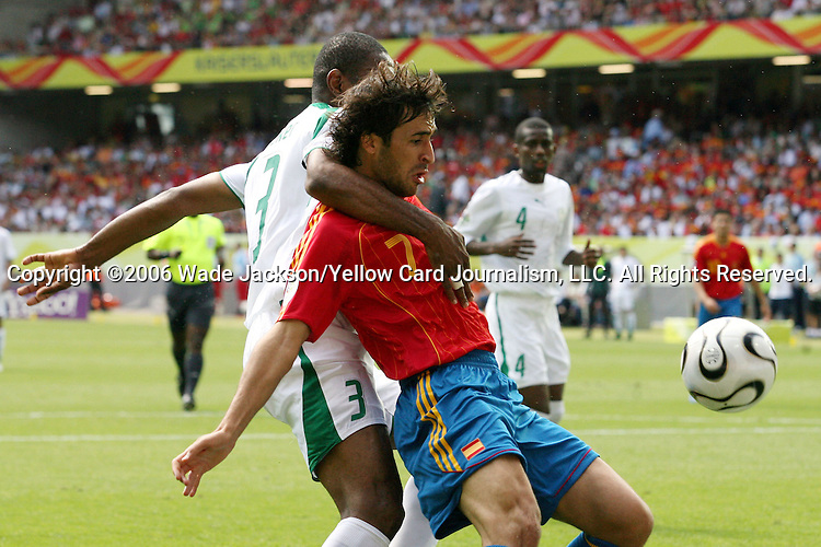 23 June 2006: Raul (ESP) (7) looks to make a play on the ball with the arm of Redha Tukar (KSA) (3) draped over his shoulder. Spain defeated Saudi Arabia 1-0 at Fritz-Walter Stadion in Kaiserslautern, Germany in match 47, a Group H first round game, of the 2006 FIFA World Cup. With the win, Spain goes through as the top team in Group H, while Saudi Arabia is eliminated with the loss.