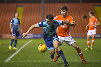 Luke O'Nien of Wycombe Wanderers holds off Michael Cain of Blackpool during the The Checkatrade Trophy match between Blackpool and Wycombe Wanderers at Bloomfield Road, Blackpool, England on 10 January 2017. Photo by Andy Rowland / PRiME Media Images.