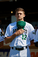 Augusta GreenJackets pitcher Keaton Winn (12) during the national anthem before a South Atlantic League game against the Lexington Legends on April 30, 2019 at SRP Park in Augusta, Georgia.  Augusta defeated Lexington 5-1.  (Mike Janes/Four Seam Images)