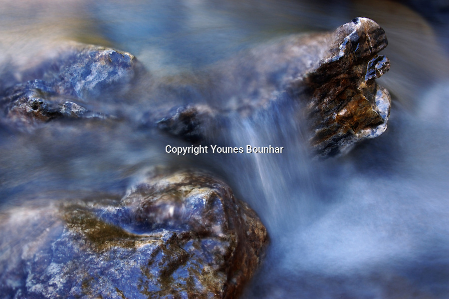 Detail shot and abstract of water cascading through rocks in Banff National Park