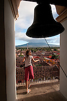 Young woman enjoying the view from bell tower at Iglesia La Merced, Granada, Nicaragua