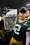 Green Bay Packers kicker Mason Crosby (2) holds up a Milwaukee Journal Sentinel after winning Super Bowl XLV against the Pittsburgh Steelers on Sunday, February 6, 2011, in Arlington, Texas. The Packers won 31-25. (AP Photo/David Stluka)