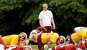 Ashburn, VA - June 16, 2007 -- Washington Redskin Head Coach Joe Gibbs watches as his players do their stretching exercises during the second day of their second and final mini-camp at Redskin Park in Ashburn, Virginia on Saturday, June 16, 2007..Credit: Ron Sachs / CNP