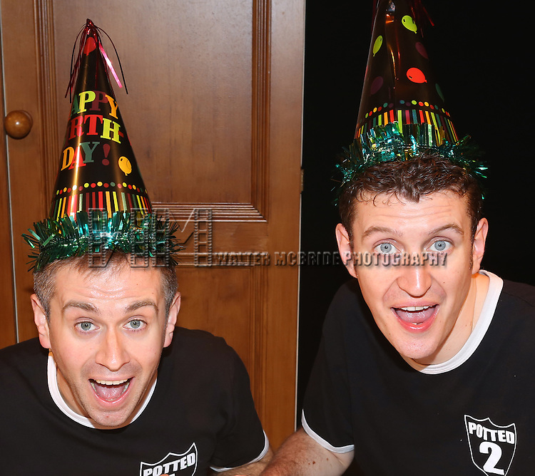 """Jefferson Turner and Daniel Clarkson from """"Potted Potter"""" backstage celebrating """"Harry Potter"""" And J.K. Rowling's Birthday at Little Shubert Theatre on July 30, 2013 in New York City."""