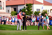 Jon Rahm (ESP) on the 18th green celebrating after winning  the DP World Tour Championship and race to Dubai with Mike Lorenzo-Vera (FRA) at the Jumeirah Golf Estates, Dubai, United Arab Emirates. 24/11/2019<br /> Picture: Golffile | Fran Caffrey<br /> <br /> <br /> All photo usage must carry mandatory copyright credit (© Golffile | Fran Caffrey)