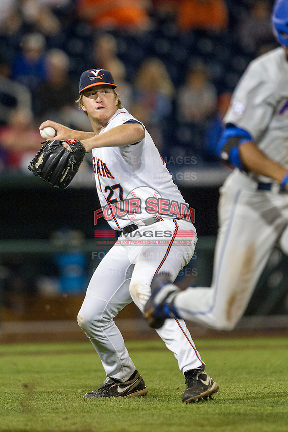 Virginia Cavaliers pitcher Josh Sborz (27) makes a throw to first base during the NCAA College baseball World Series against the Florida Gators on June 15, 2015 at TD Ameritrade Park in Omaha, Nebraska. Virginia defeated Florida 1-0. (Andrew Woolley/Four Seam Images)